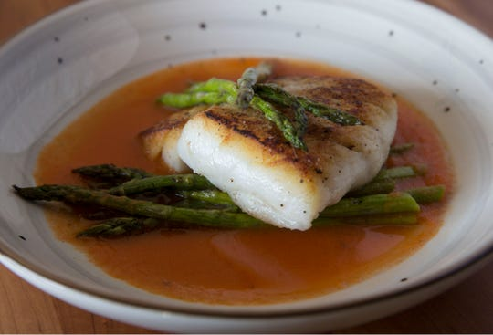 Seared corvina with asparagus, tomato jus and basil oil at Genevieve's in Seaside Heights.