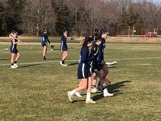 The Freehold Township girls lacrosse team rushes onto the field to start the 2nd half against Wall on March 27, 2019.