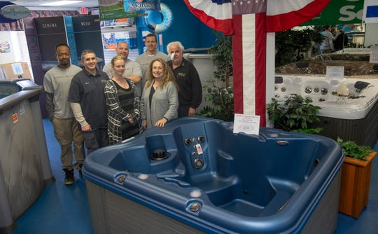 Rich Rosa, owner of Intregrity Pool & Spa in Lanoka Harbor with his family and staff. The family owned and operated company specializes in in-ground and above ground pool installation and spas for over 19 years.
