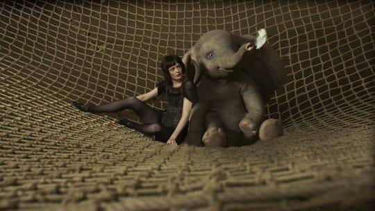 """Eva Green, left, and Dumbo in Disney's """"Dumbo."""""""