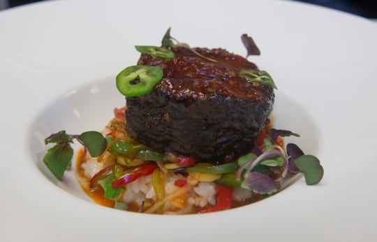 Korean short rib with sticky rice, vegetable stir fry and Fresno chili pepper at Rumson House in Rumson.