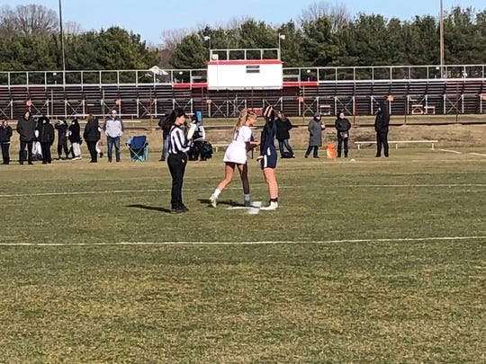 The Wall and Freehold Township girls lacrosse teams get ready to take the opening draw of the second half on March 27, 2019