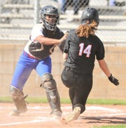 Cooper catcher Symone Gary tags out Aledo's Hollyn Gaffner at home plate for the second out of the third inning. Gaffner was trying to score on Macy Graf's single to center, but Cooper center fielder Keiana Kemp gunned her down at home to preserve a scoreless game. Cooper beat the Ladycats 3-2 in the District 4-5A game Tuesday, March 26, 2019, at Cougar Diamond.