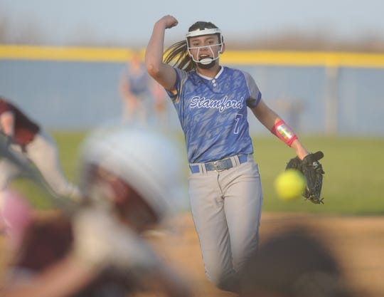 Stamford freshman Citlaly Gutierrez (7) delivers a pitch against Hawley on Tuesday, March 26, 2019, in Stamford.