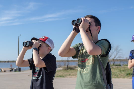 Henry Proctor (right) and Joel Dantzler look through their binoculars.