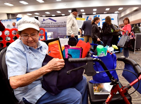 Ruby Fitzpatrick sorts the swag she picked up during Wednesday's Business Expo at the Abilene Convention Center.