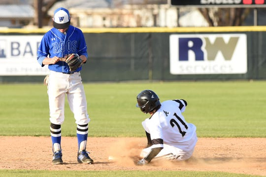 Abilene High's Reese Pettijohn (21) slides safely into second without a throw against Weatherford on Tuesday, March 26, 2019. The Eagles fell 3-2 in nine innings.