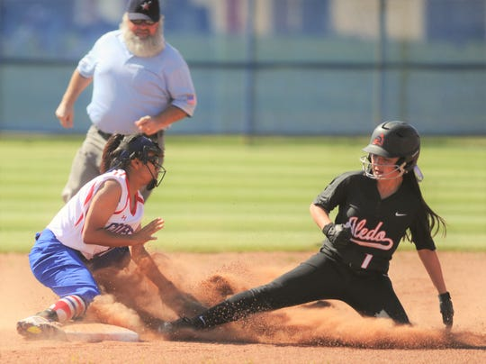 Cooper shortstop Angelic Gonzalez, left, tags out Aledo's Macy Graf on a stolen base attempt in the first inning. Graf had singled to start the game and then attempted the steal only to be thrown out by Cooper catcher Symone Gary. The Lady Cougars beat Aledo 3-2 in the District 4-5A game Tuesday, March 26, 2019, at Cougar Diamond.