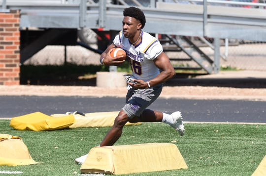 Hardin-Simmons running back Jaquan Hemphill (16) carries the ball during the Cowboys' first spring practice of 2019. Hemphill missed most of the 2018 season with an injury, but came back this season as is rewriting the HSU record book.
