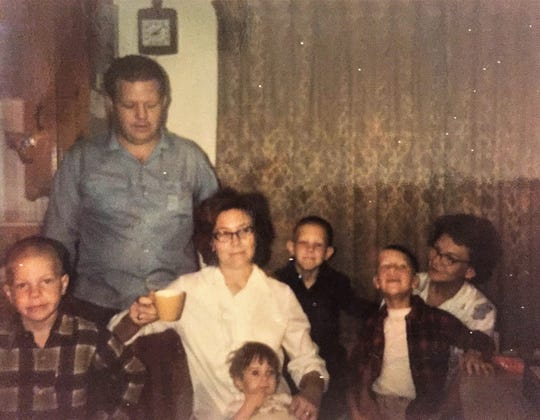 Gary Boles' family, back in the day. The young girl is Kristy, whom the family adopted in San Antonio and where, now a mission, the Aldersgate UMC pastor recently revisited for the first stop.