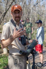 Jay Packer speaks to a group of young birders during a day out at Kirby Lake on March 25.