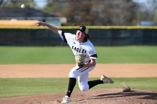 Abilene High pitcher Ryan Johnson (27) lets go of the ball against Weatherford on Tuesday, March 26, 2019. The Eagles fell 3-2 in nine innings.