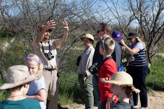 Jay Packer explains the importance of the habitat around Kirby Lake to birds to a group of young birding enthusiasts.