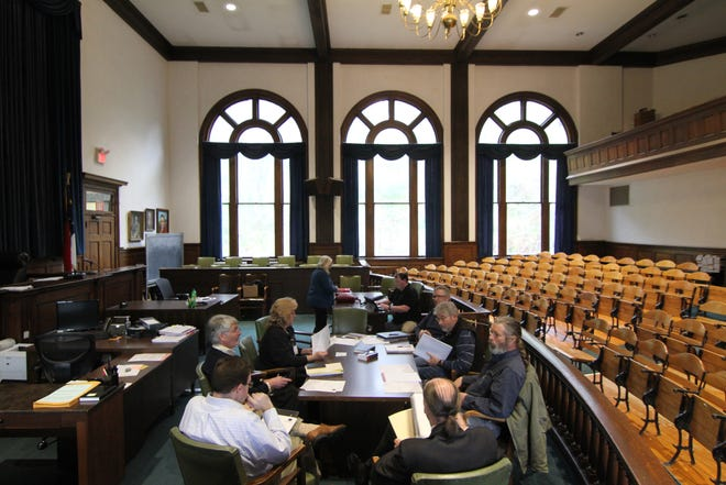 The Madison County board of adjustments met inside an empty courthouse March 25. Their April 22 session, when a hearing on local permitting for a planned asphalt plant is set to begin, will likely fill the 1907 courtroom with supporters and opponents of the project.