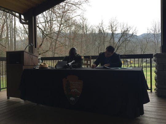 Great Smoky Mountains National Park Superintendent Cassius Cash And Eastern Band of Cherokee Principal Chief Richard Sneed sign an historic agreement March 25, 2019, to allow tribal members to harvest sochan in the park.