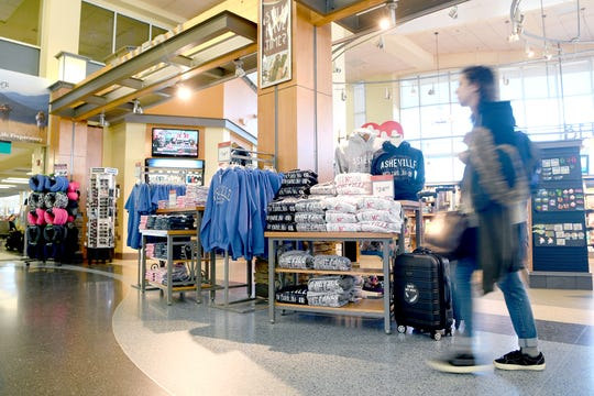 Asheville t-shirts are for sale in the Asheville Regional Airport's gift shop which also sells coffee, food, books and has a bar.