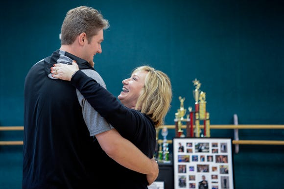 Angie Henley, owner of Angie's Dance Academy in Clyde, dances with her son, Landon, at her studio March 22, 2019. Landon found success as a dancer through the studio growing up but has turned his focus toward school sports at Tuscola High School.