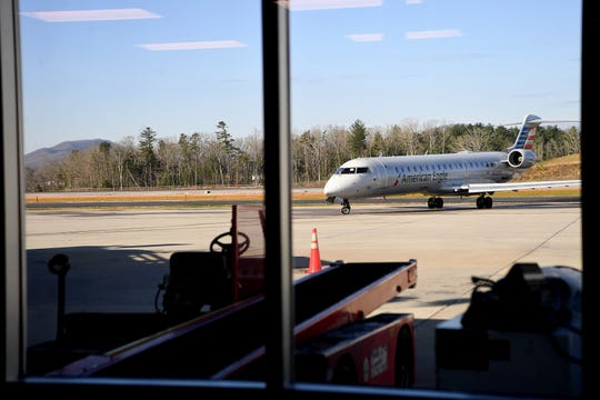 An American Eagle plane waits to take off at the Asheville Regional Airport on March 27, 2019.