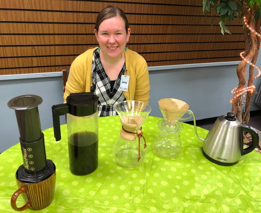 Jenny de Jong, Willard Library creative services librarian, displays some of the different ways of brewing coffee that will be discussed at the library's monthly Coffee Club.