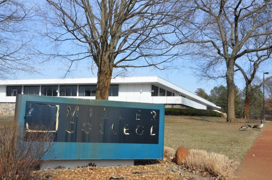 A blacked-out sign in front of the Kellogg Community College Mawby Center, which used to house  Robert B. Miller College. Miller College closed in 2016.