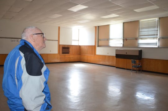 "Jim Smith, a 1959 graduate of Springfield High School, let out an audible ""wow"" as he toured his old band room inside The Gathering Place. The north end of the building, owned by the Burma Center, is set to be leased by Calhoun Community High School beginning in the 2019-20 school year."