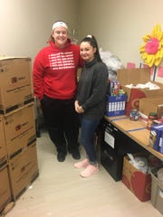 Sydney Feeko and Windsor Knight Pack creator and president Alexis Green sort out food donations.