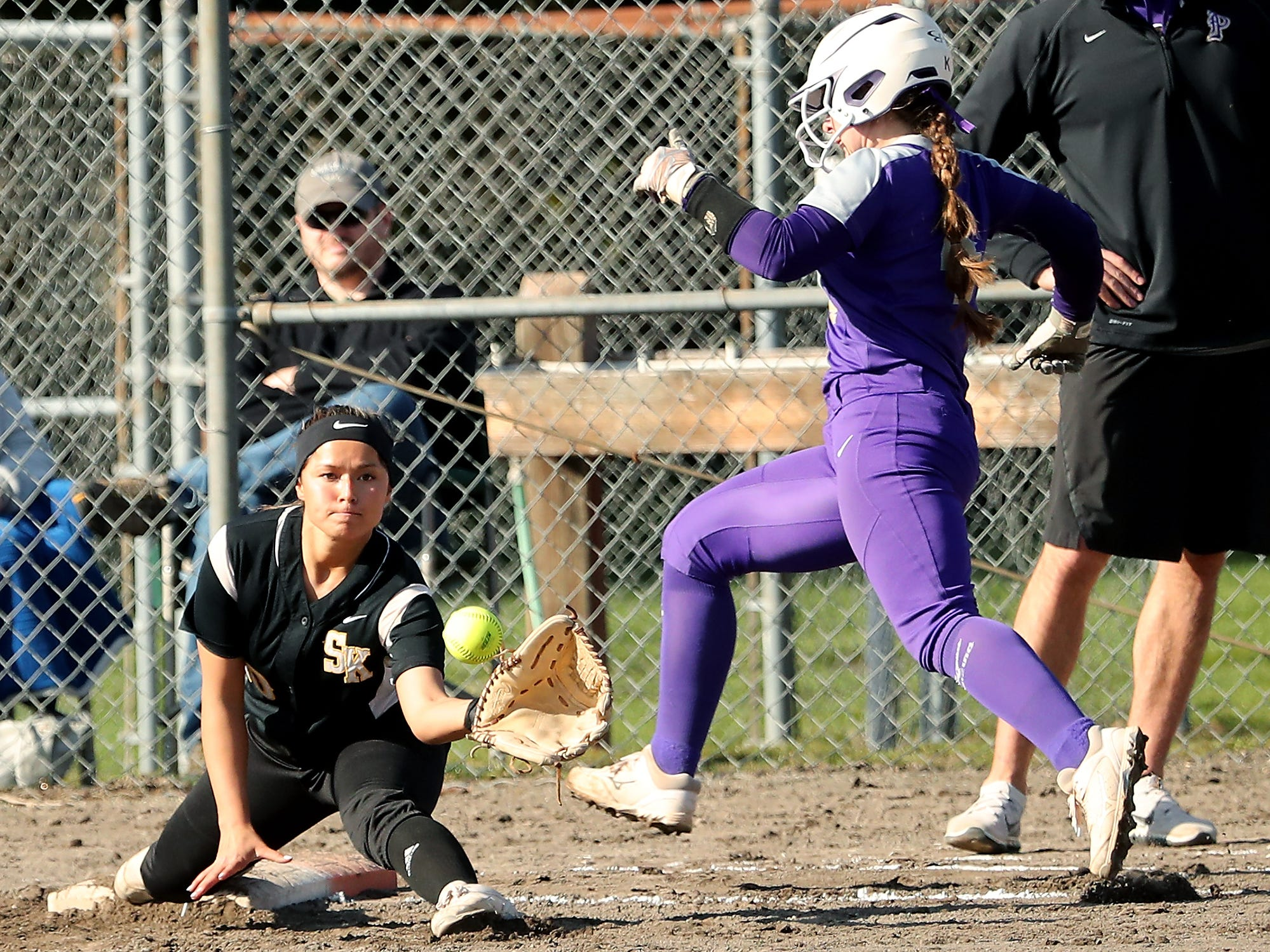 South Kitsap's Jordynn Lawrence makes the catch and Puyallup's McKennah (KJ) Ulrey is out at first on Tuesday, March 26, 2019.