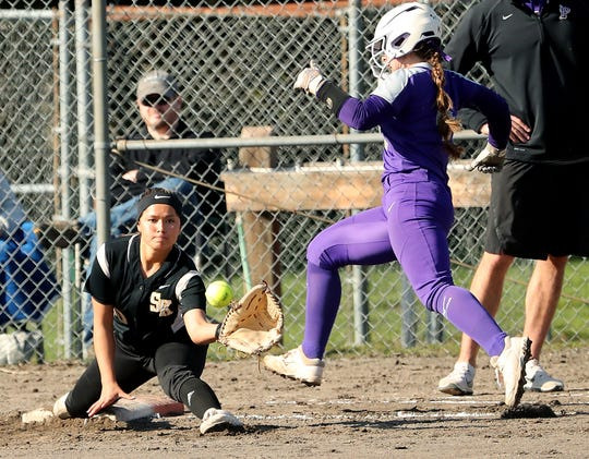 South Kitsap's Jordyn Lawrence, left, will be among the players competing in the Softball Showcase at the Kitsap County Fairgrounds on Wednesday.