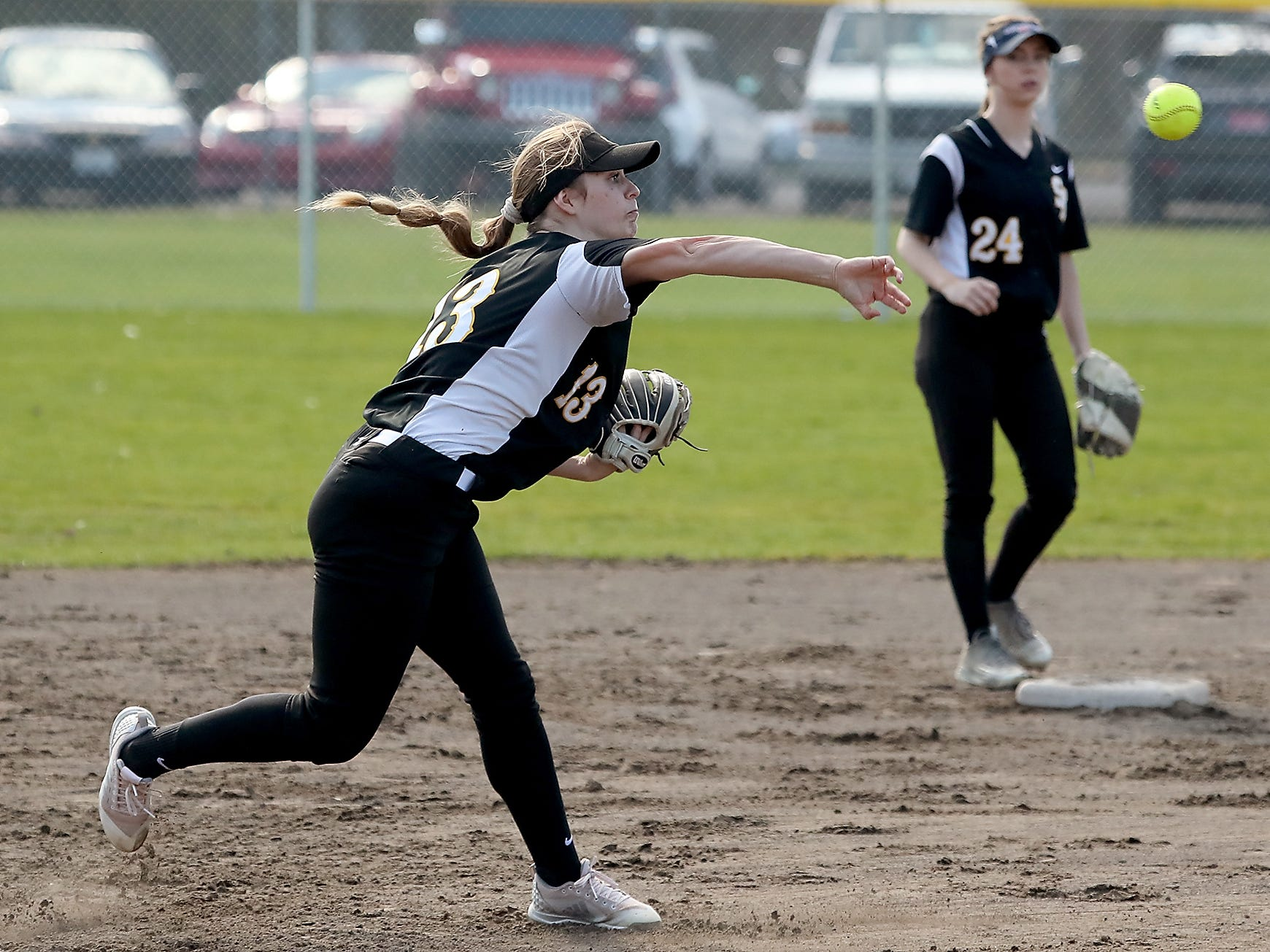 South Kitsap's Kaitlynn Johnston fires a throw to first against Puyallup on Tuesday, March 26, 2019.