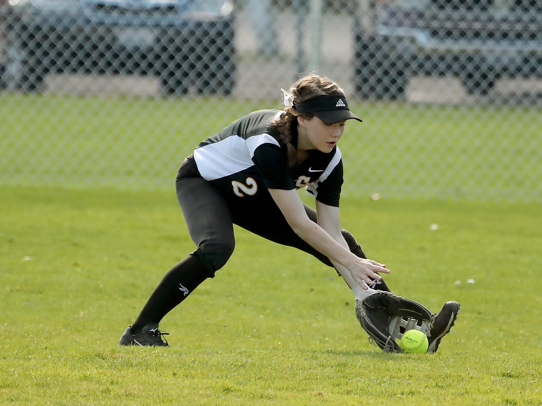 South Kitsap's Myanna Henke scoops up a ground ball against Puyallup on Tuesday, March 26, 2019.