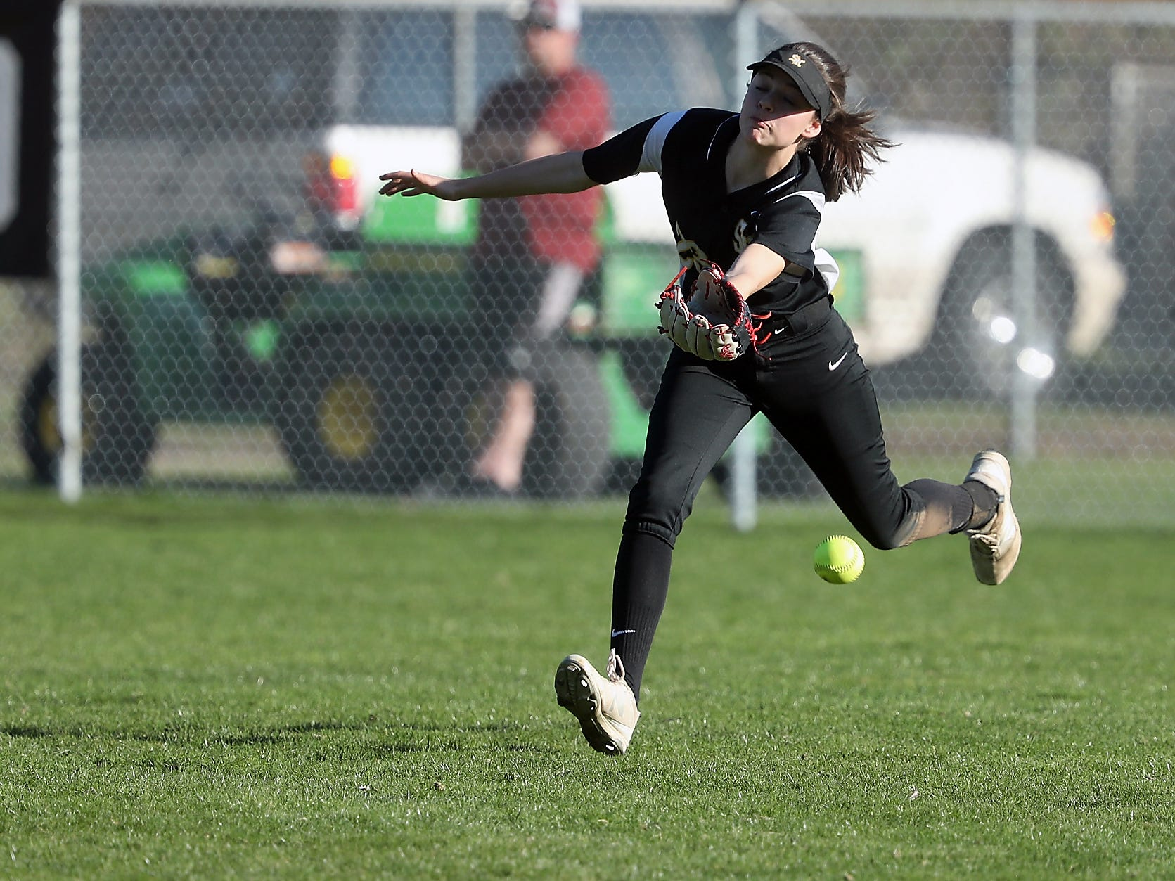 South Kitsap's Aubrey Faucett misses a fly ball against Puyallup on Tuesday, March 26, 2019.