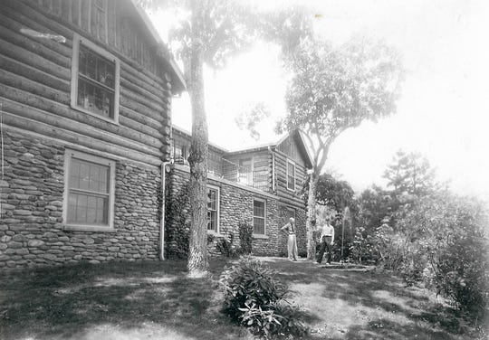 Dr. Willis D. Weatherford and his wife Julia stand behind Far Horizons, their Blue Ridge Assembly home, in 1940.