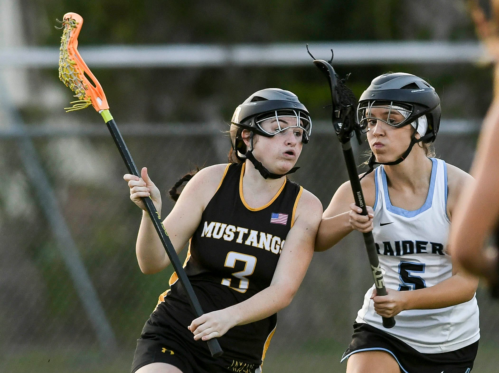 Maddie Brake of Merritt Island is shadowed by Hope Campbell of Rockledge during Tuesday's game.