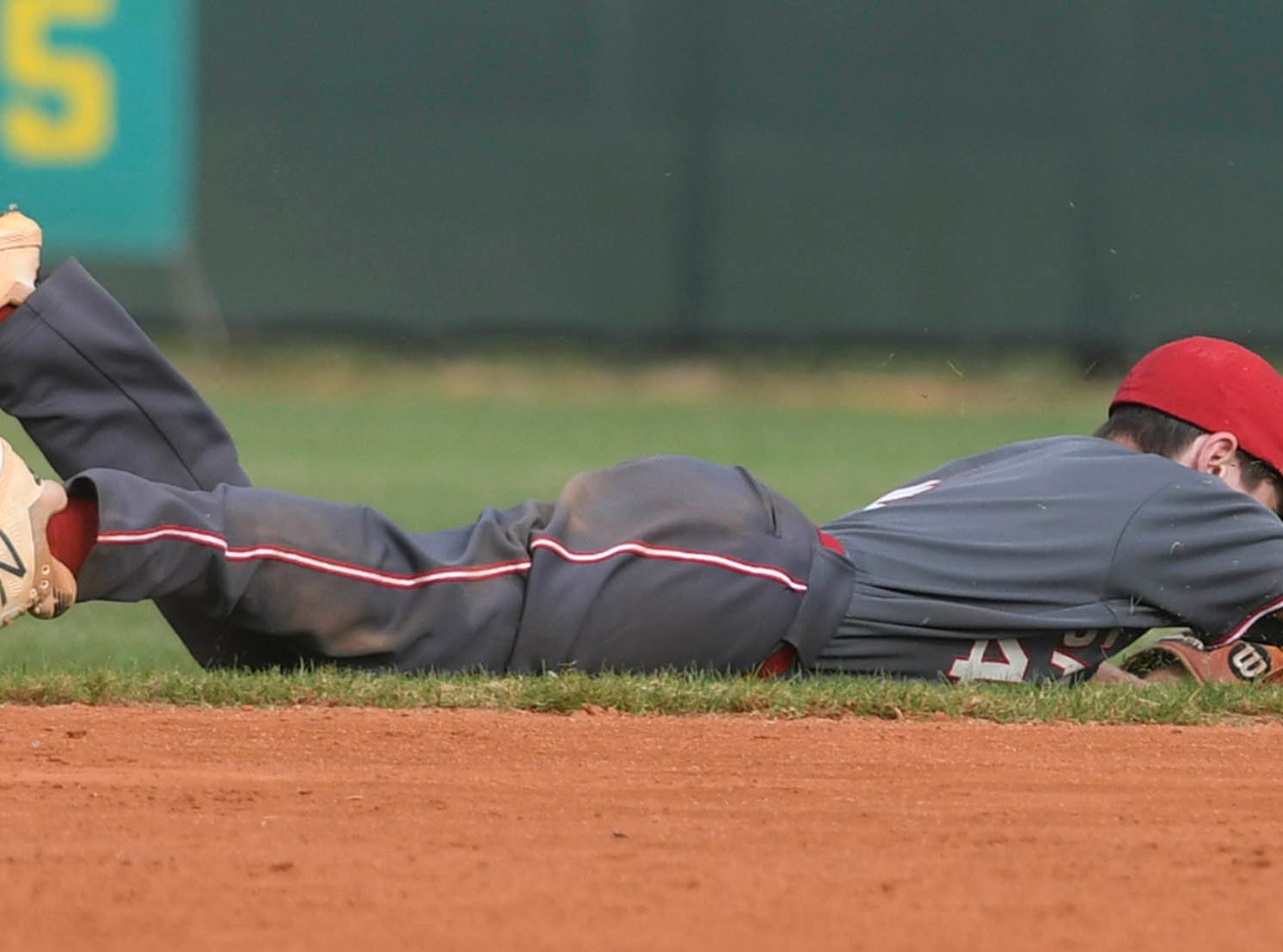 Satellite's Nathan Westfield just misses a hard hit grounder during Tuesday's game against Melbourne Central Catholic.