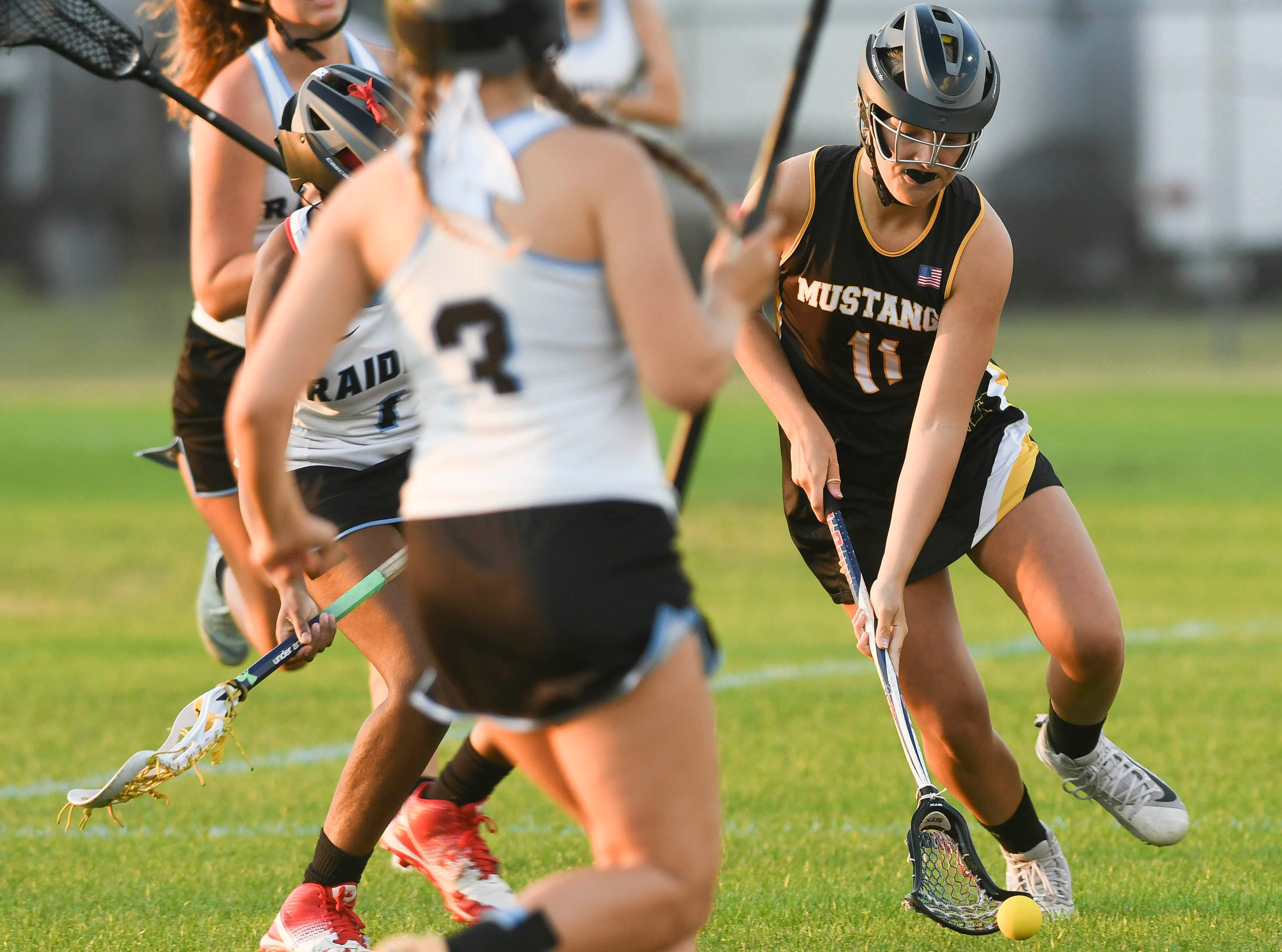 Keely Hannam of Merritt Island scoops up the ball during Tuesday's game against Rockledge.