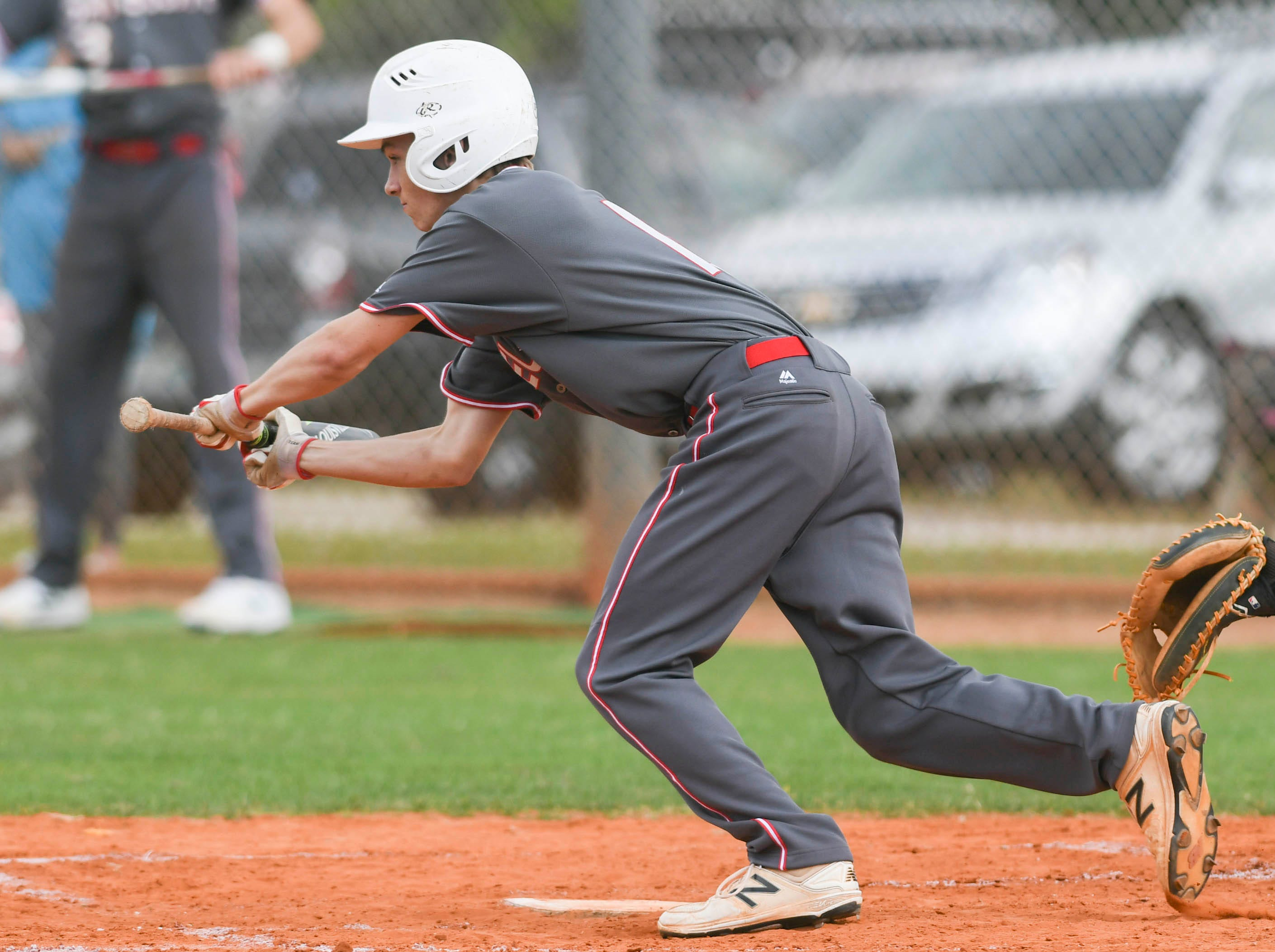 Ryland Sacik of Satellite attempts a bunt during Tuesday's game against Melbourne Central Catholic.