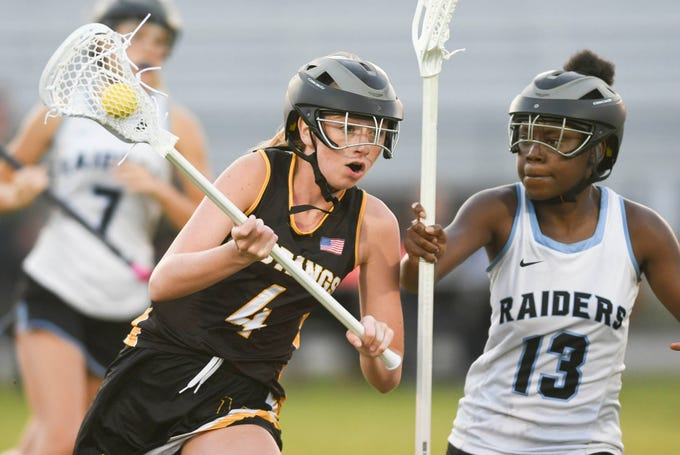 Merritt Island's Heather Johnston is guarded by Raven Kearse of Rockledge during Tuesday's game.
