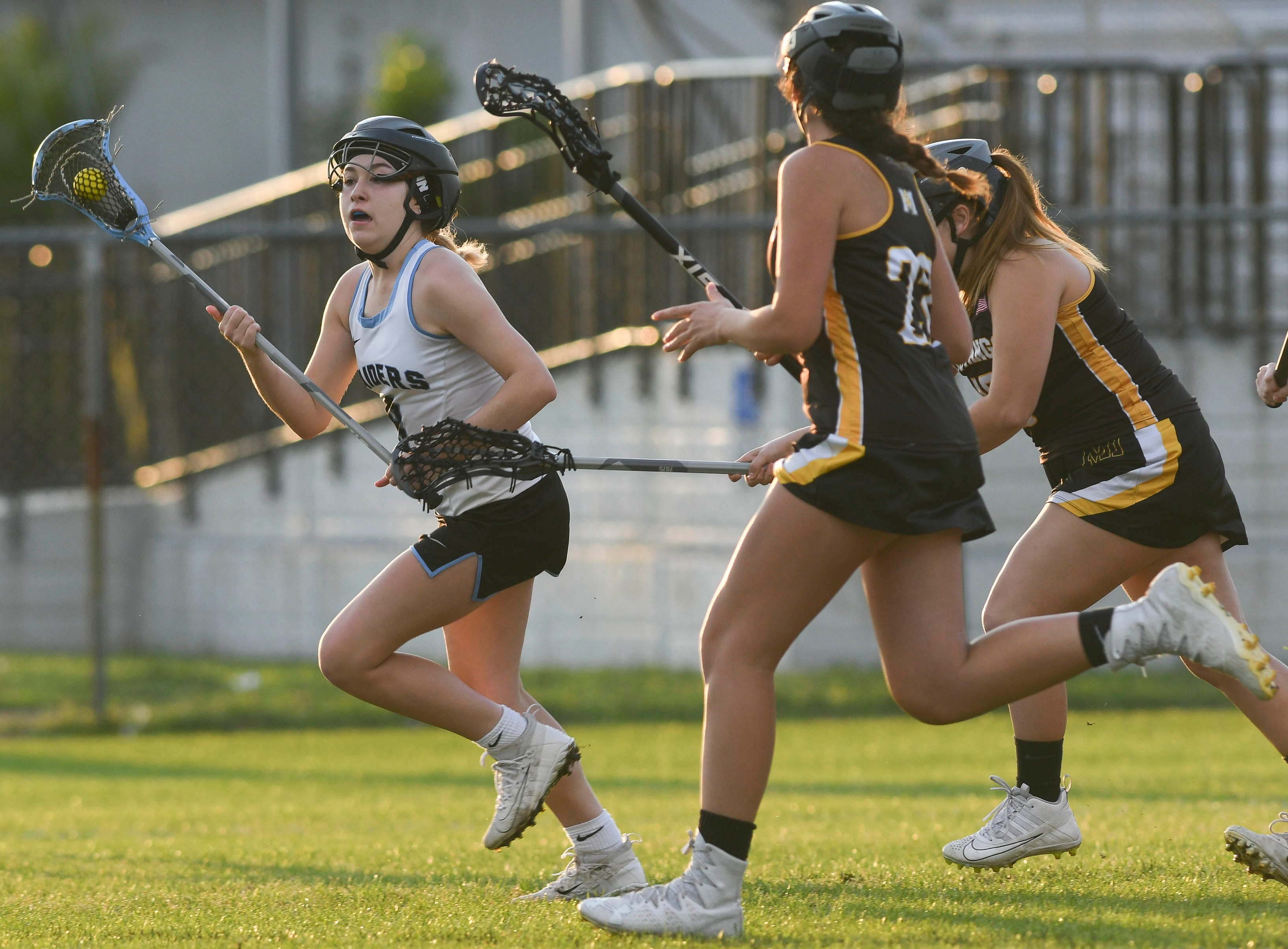 Sofia Baldwin of Rockledge is pursued by Merritt Island defenders during Tuesday's game.