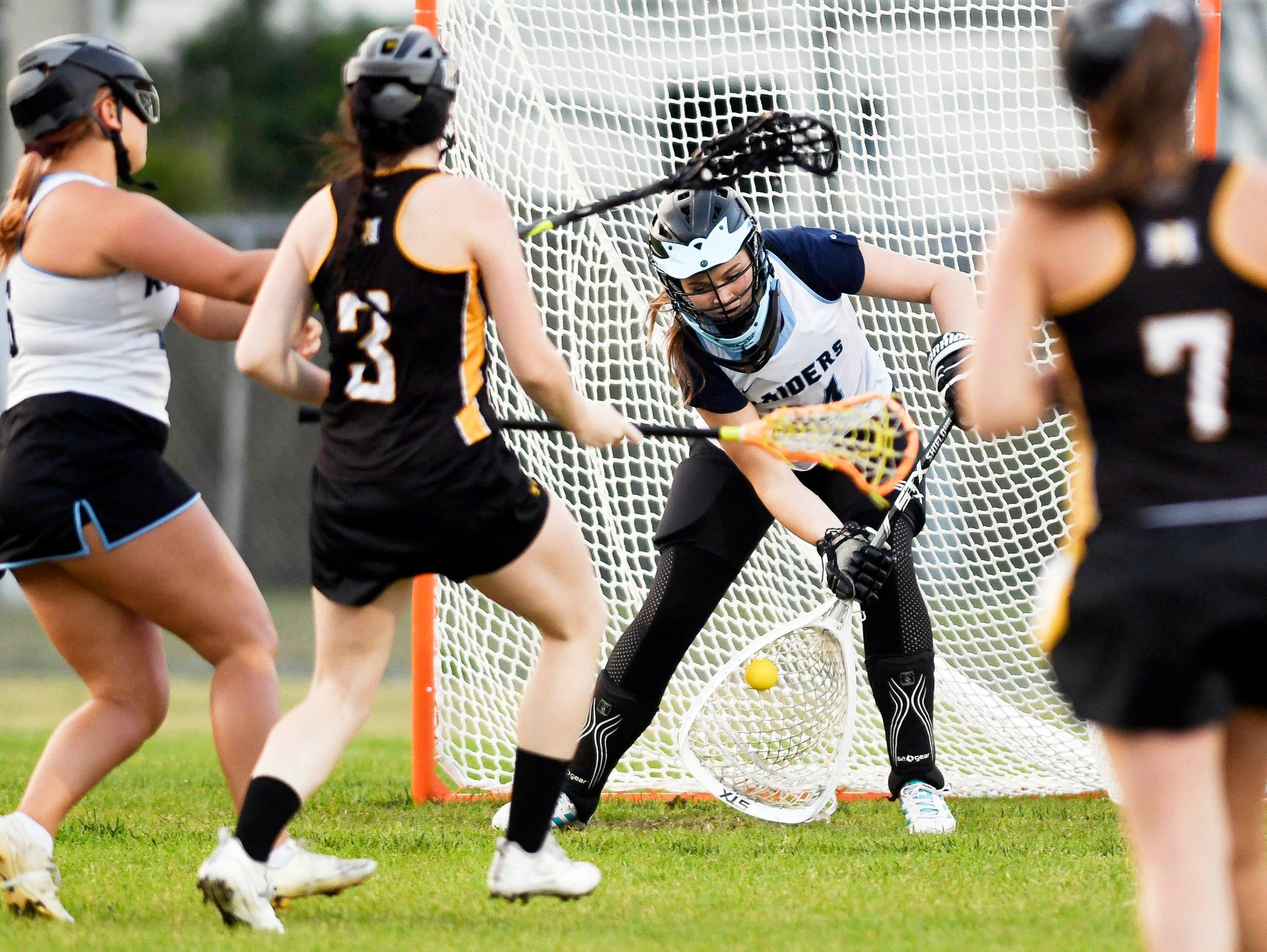 Melanie Mahaffey of Rockledge makes a save during Tuesday's game against Merritt Island.