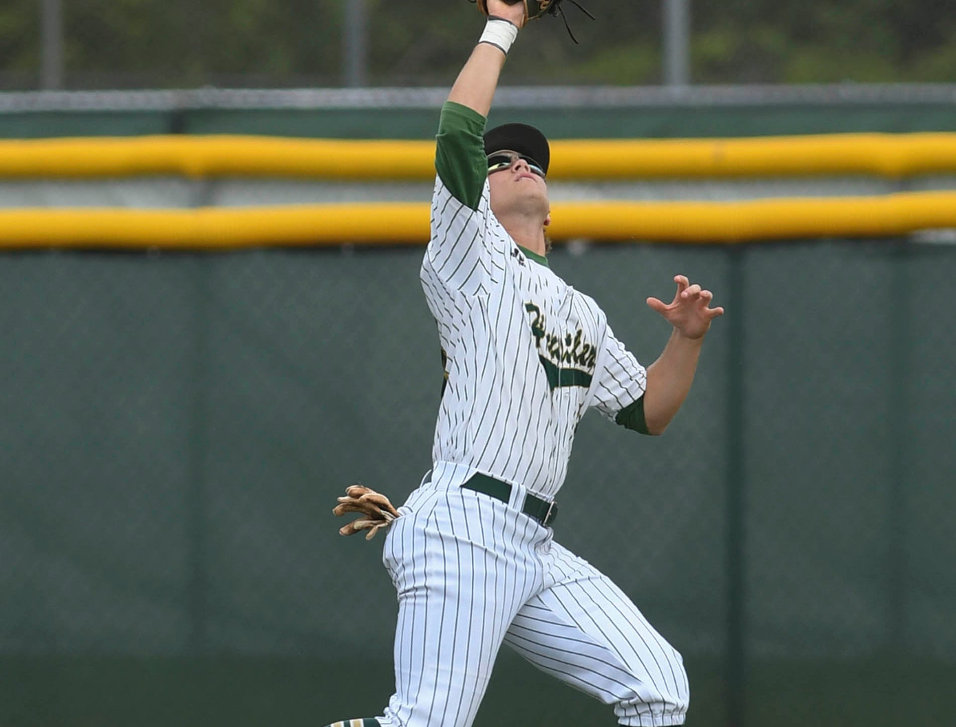Cam Maruzzella catches a fly ball during Tuesday's game against Satellite.