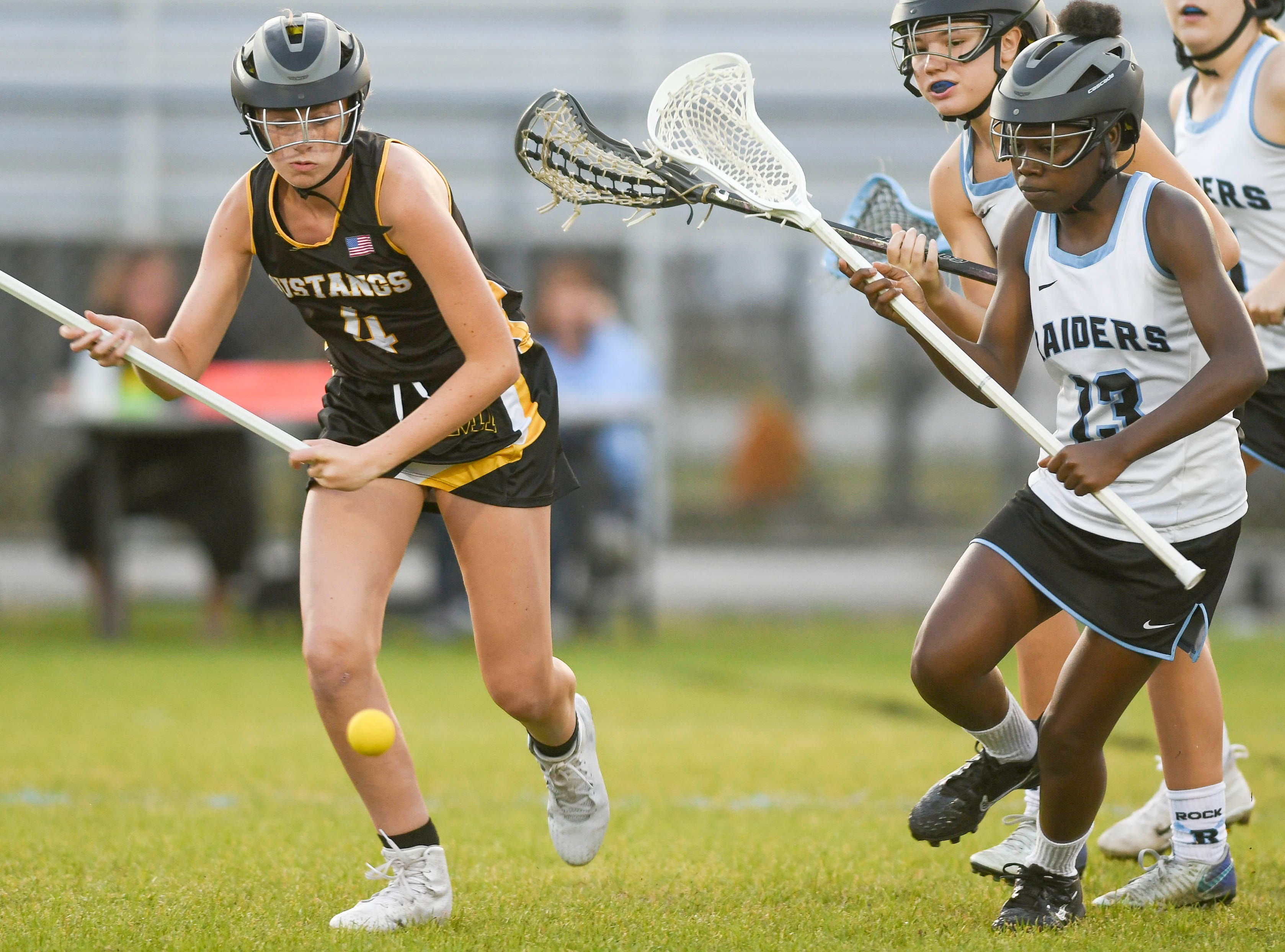 Merritt Island's Heather Johnston and Raven Kearse of Rockledge chase a loose ball during Tuesday's game.