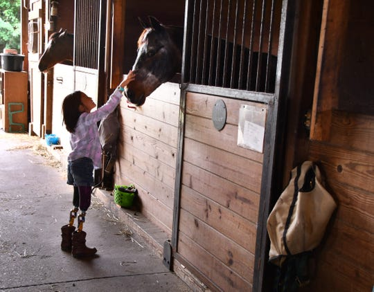 The Buckaroo Ball, a fundraiser for Harmony Farms is Saturday, March 30th at the Cocoa Convention Center. Harmony Farms offers equine assisted therapy for children like Bella and Nico Smith. Bella was born with no legs and a deformed left hand, her brother Nico was born without arms from the elbows down. Bella was petting one of the therapy horses after a ride.