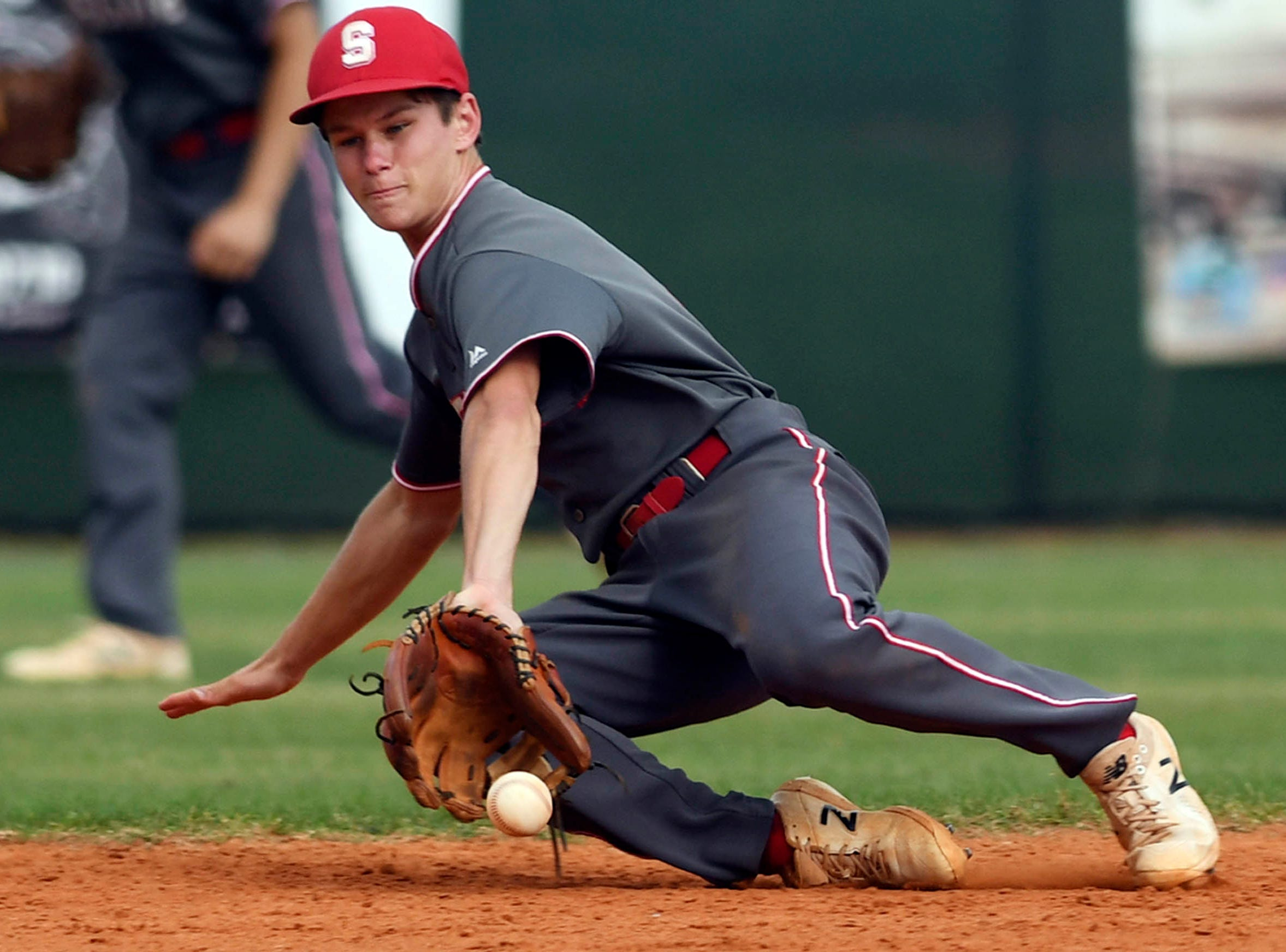 Nathan Westfield of Satellite fields a hard hit grounder during Tuesday's game against MCC.