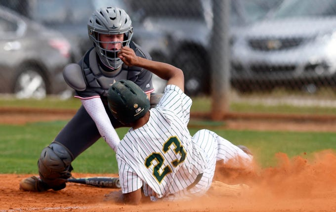 Satellite catcher Gunnar Nusl tags out Melbourne Central Catholic baserunner Bryant Espiritusanto duringTuesday's game in Melbourne.