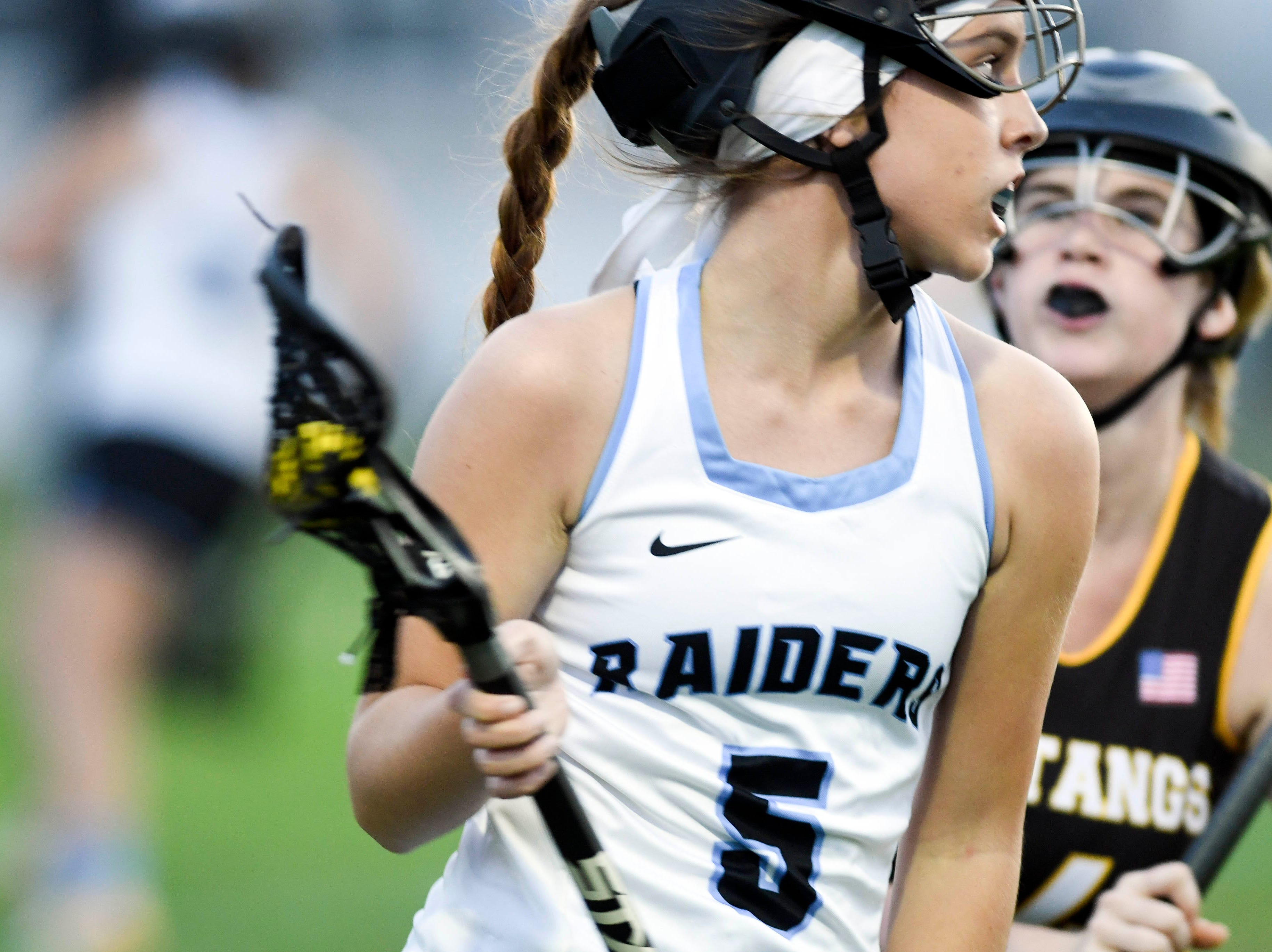 Hope Campbell of Rockledge looks for an open teammate during Tuesday's game against Merritt Island.