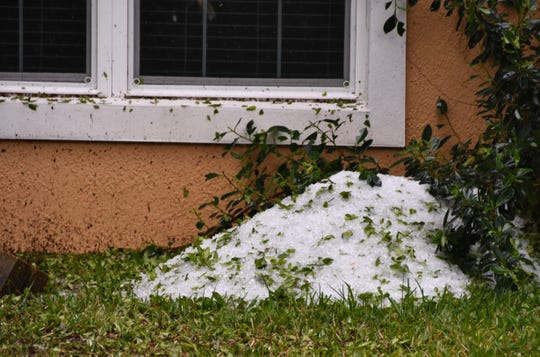 After the Wednesday morning hail storm, the hail by Horse Creek on US 1 and Rose Court in Melbourne remained on the side of the road for more than an hour, looking like snow to drivers passing by. Hail piled up by the side of a house on Rose Court an hour after the storm.