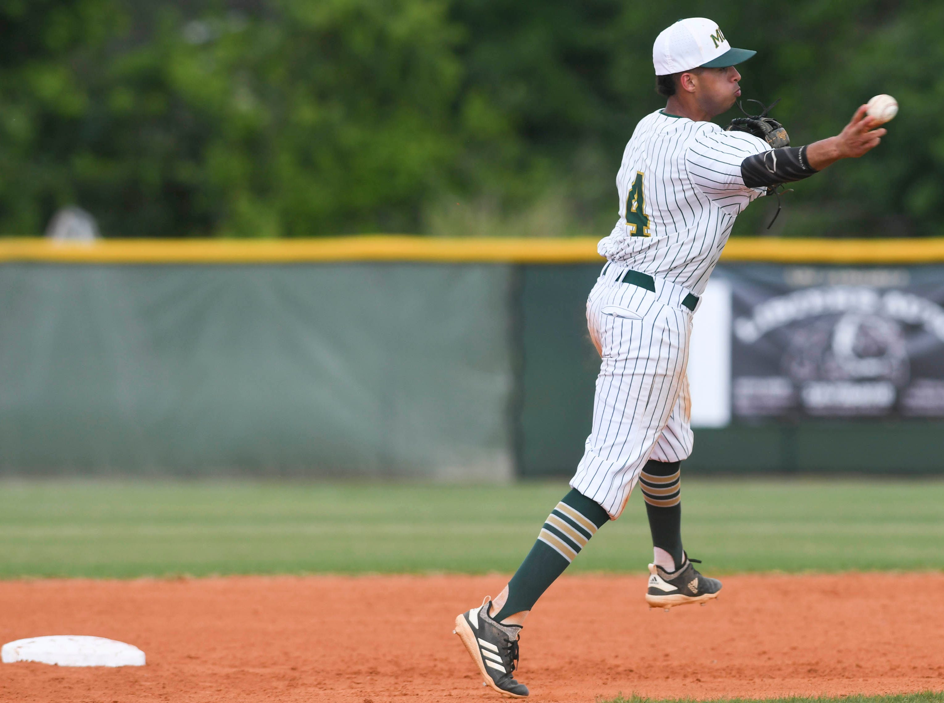 Derick Cantres of Melbourne Central Catholic throws out a baserunner during Tuesday's game against Satellite.