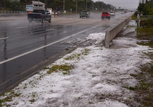 After the Wednesday morning hail storm, the hail by Horse Creek on US 1 and Rose Court in Melbourne remained on the side of the road for more than an hour, looking like snow to drivers passing by.
