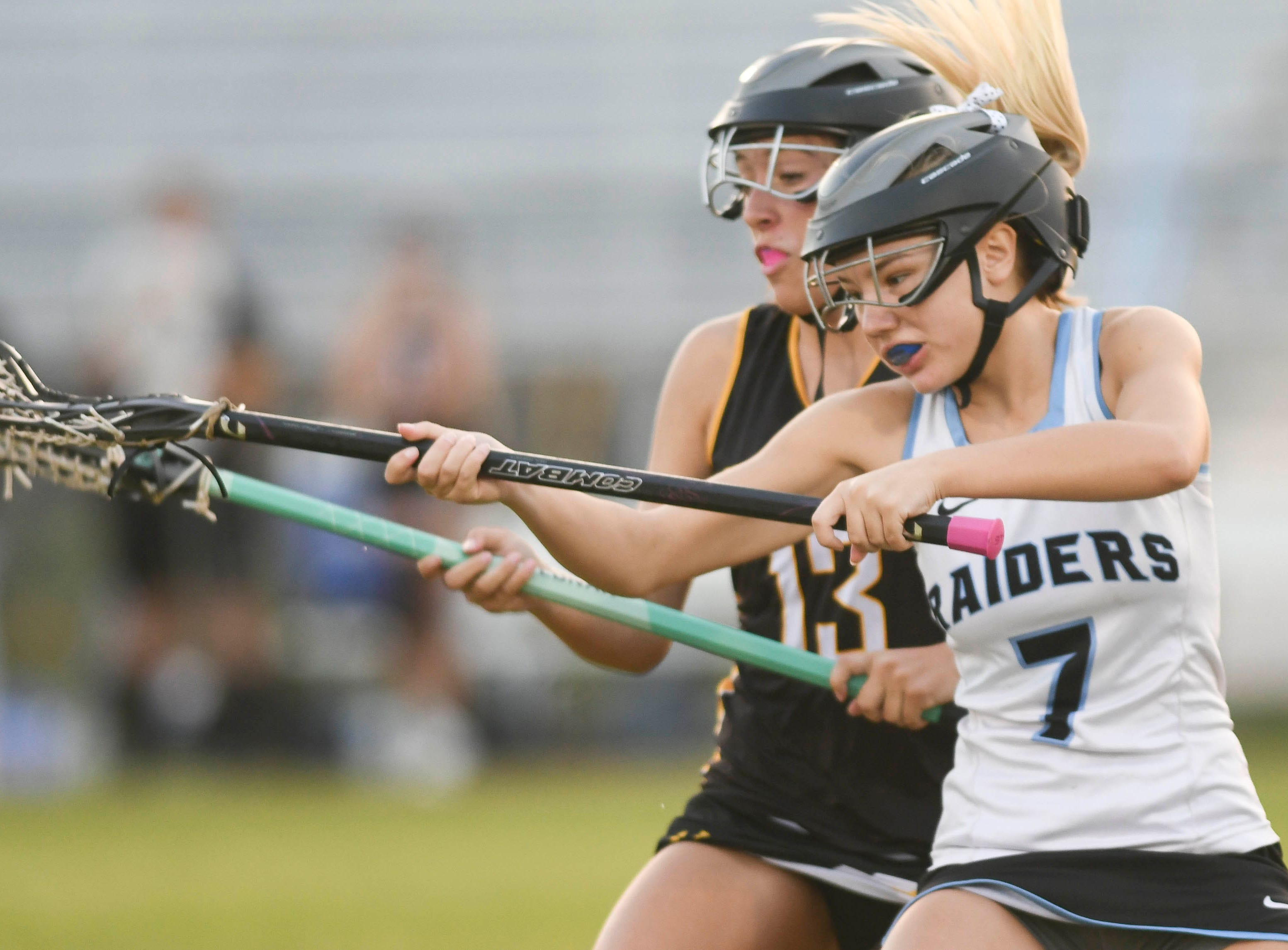 Hannah Wheat of Merritt Island and Ledger Hicks of Rockledge battle for the ball during Tuesday's game.