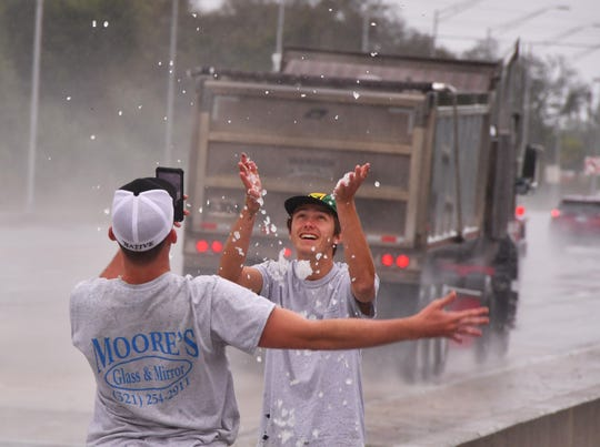 Not sure if Jordan Wallace and Adam Rossbach, who work for Moore's Glass & Mirror have ever seen snow before. They stopped by some piled up hail on US 1 near Horse Creek on US 1 to play in it and get some cdell phone photos of it on their way to a job.